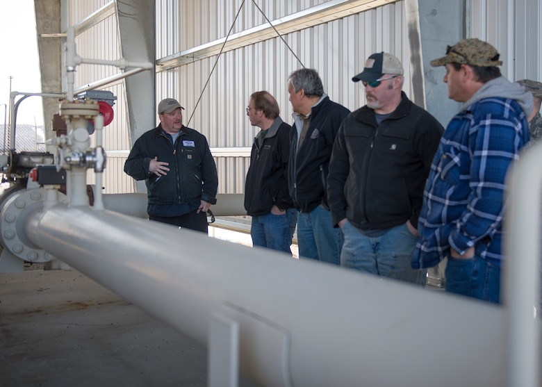 Employees from a local oil refinery and Airmen from the 354th Logistics Readiness Squadron petroleum, oils and liquids flight visit refueling facilities April 21, 2015, at Eielson Air Force Base, Alaska. The refinery supplies the base with fuel weekly to fill 25 million gallons of bulk storage. (U.S. Air Force photo by Staff Sgt. Shawn Nickel/Released)