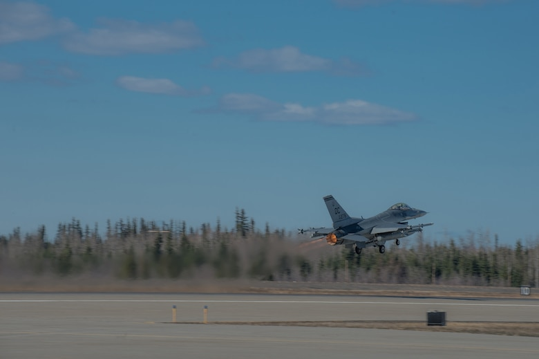 An F-16 Fighting Falcon pilot from the 113th Wing, District of Columbia Air National Guard, takes off from the flight line April 27, 2015 at Eielson Air Force Base, Alaska. The unit is preparing to participate in RED FLAG-Alaska 15-2 large-force employment training. (U.S. Air Force photo by Staff Sgt. Shawn Nickel/Released)