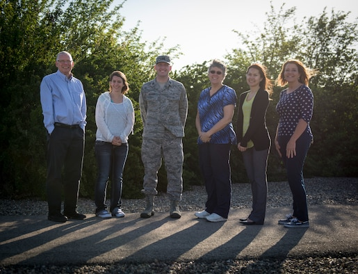 Family Advocacy members pose for a photo at Mountain Home Air Force Base, Idaho, April 30, 2015. Family Advocacy offers many services to help families live safe, happy and healthy lifestyles. (U.S. Air Force photo by Airman 1st Class Jessica H. Smith/RELEASED)
