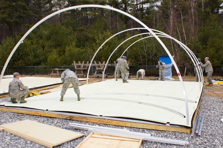 U.S. Air Force civil engineers from the 116th Civil Engineer Squadron, Georgia Air National Guard, erect a small shelter system, or Triple S, at Camp William Hinds Boy Scout Camp, Raymond, Maine, April 20, 2015. The squadron, from Robins Air Force Base, Ga., spent two weeks at the camp as part of the Innovative Readiness Training program where they are the lead unit that kicked off a project to construct a new dining facility for the Boy Scout camp. The two week deployment provided the opportunity for the squadron to get real-world training similar to the way they will be deploying in the future. The Airmen set up nine tents, installed an entire electrical grid, renovated electrical, plumbing and HVAC systems on two shower shave trailers, and worked with the duration staff to ensure materials and equipment are on site to continue the mission for future rotations