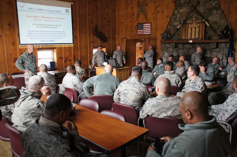 U.S. Air Force civil engineers from the 116th Civil Engineer Squadron, Georgia Air National Guard, gather for a briefing after arriving at Camp William Hinds Boy Scout Camp, Raymond, Maine, April 20, 2015. The squadron, from Robins Air Force Base, Ga., spent two weeks at the camp as part of the Innovative Readiness Training program where they are the lead unit that kicked off a project to construct a new dining facility for the Boy Scout camp. The two week deployment provided the opportunity for the squadron to get real-world training similar to the way they will be deploying in the future. The Airmen set up nine tents, installed an entire electrical grid, renovated electrical, plumbing and HVAC systems on two shower shave trailers, and worked with the duration staff to ensure materials and equipment are on site to continue the mission for future rotations. (Contributed photo/Released)