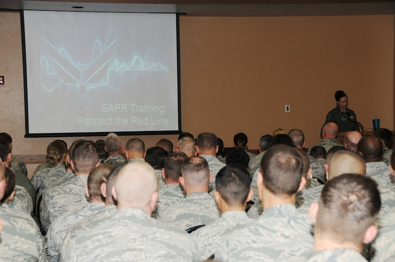 "Maj. Jessica Hastings, 161st Air Refueling Wing sexual assault response coordinator, leads nearly 700 Airmen in the annual Sexual Assault Prevention and Response training at the 161st Air Refueling Wing, Phoenix, April 12. Quoting Air Force Chief of Staff Gen. Mark A. Welsh III regarding the effectiveness of the SAPR program, Hastings said, ""Until there are zero sexual assaults, we are not done."" (U.S. Air National Guard photo by Tech. Sgt. Courtney Enos)"