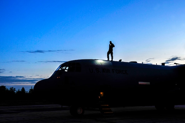 Airman 1st Class Tyler Otis, a 19th Aircraft Maintenance Squadron crew chief, looks for damage on a C-130 April 22, 2015, at Little Rock Air Force Base, Ark. During flight, birds can hit the aircraft and cause serious damage.(U.S. Air Force photo by Senior Airman Stephanie Serrano)
