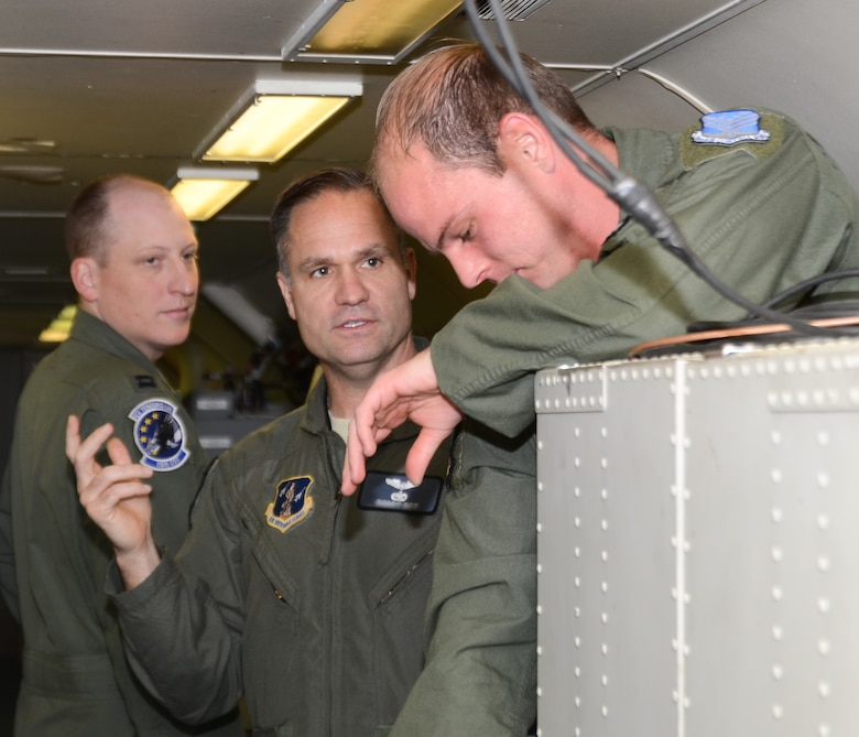 A U.S. Air Force, mission crew commander with the 116th Air Control Wing, Georgia Air National Guard, talks with members of his crew aboard the E-8C Joint STARS aircraft prior to participation in the Emerald Warrior exercise, Robins Air Force Base, Ga., April 23, 2015.  During the exercise, Airmen and Soldiers from the 116th Air Control Wing and the 138th Military Intelligence Company provided real-time maritime over-watch using the one-of-a-kind battle management command and control, intelligence, surveillance and reconnaissance capabilities of the E-8C Joint STARS to joint and allied forces during a lost diver scenario. (U.S. Air National Guard photo by the 116th Air Control Wing Public Affairs/Released) (Names of aircrew members withheld for security purposes)
