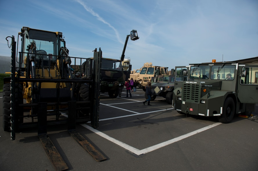Students from Spangdahlem Elementary School check out military vehicles during Kids' Deployment Day at Spangdahlem Air Base, Germany, April 29, 2015. Children interacted with multiple vehicles including security forces patrol cars and a fire truck as a part of their simulated deployment to Rio De Janeiro. (U.S. Air Force photo by Airman 1st Class Luke Kitterman/Released)
