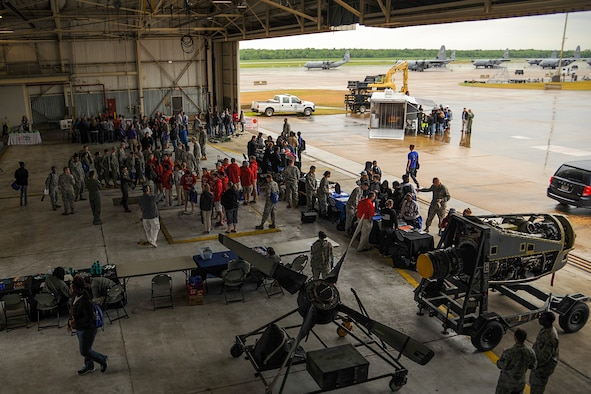 High school students from regional Junior ROTC programs view displays from different agencies and squadrons inside Hangar 233 April 23, 2015, at Little Rock Air Force Base, Ark. The demonstration was part of the annual Junior ROTC Expo that provides an overview of the mission at Little Rock AFB. (U.S. Air Force photo by Senior Airman Harry Brexel)