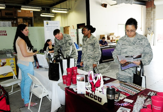 Members of the 145th Airlift Wing took part in the annual Educational Fair held at the North Carolina Air National Guard base, Charlotte Douglas Intl. Airport, April 18, 2015.  University of North Carolina System, a multi-campus university composed of all 16 of North Carolina's local and state institutions, came to showcase programs they offer to veterans including baccalaureate, masters and doctoral degrees. More than 45 airmen visited representatives participating in the event. (U.S. Air National Guard photo by Master Sgt. Patricia F. Moran, 145th Public Affairs/Released)