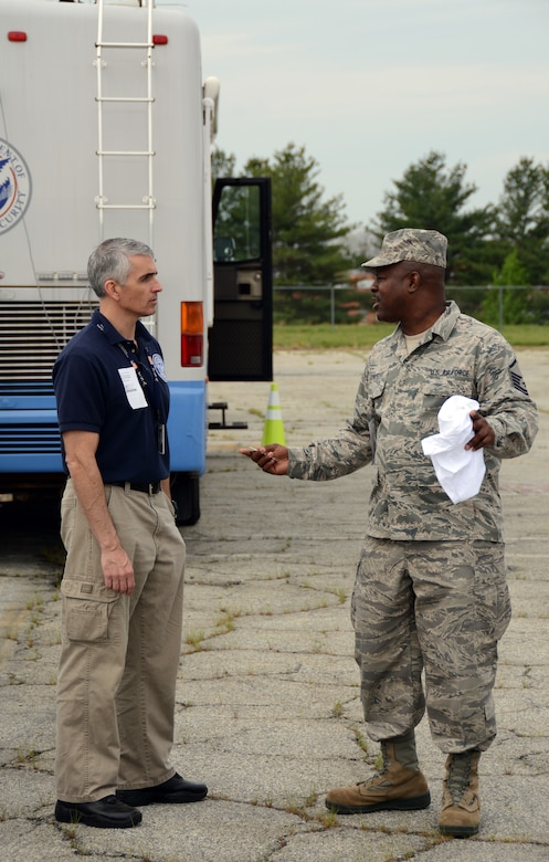 U.S. Air Force Master Sgt. Timothy Jones, Superintendent of Operations for the 156th Aeromedical Evacuation Squadron, meets with Robert Nicholson, Jones civilian counterpart with the Transportation Security Administration, during a North Carolina Command and Communications rally held in Greensboro, N.C. April 10, 2015. NCANG partnered with more than twenty Emergency Management agencies and provided a Mobile Emergency Operations Center to test communications during a natural disaster exercise. The Rally allowed for North Carolina Emergency Management agencies to connect, and understand the assets available for any state or possibly national incidents and disasters that may occur. (U.S. Air National Guard photo by Senior Airman Laura Montgomery, 145th Public Affairs/Released)