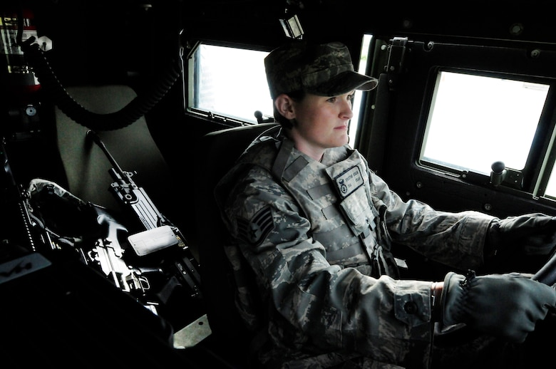 Newly promoted U.S. Air Force Staff Sgt. Kristine Koch, 145th Security Forces Squadron, starts an armored Humvee for patrol during a training exercise held in the Uwharrie National Forest, Troy, N.C., April 2, 2015. Koch, who completed her first Professional Military Education milestone, Feb 12, 2015, as a distinguished graduate from Airman Leadership School has been with 145th SFS since Oct 2012. (U.S. Air National Guard photo by Master Sgt. Patricia F. Moran, 145th Public Affairs/Released)