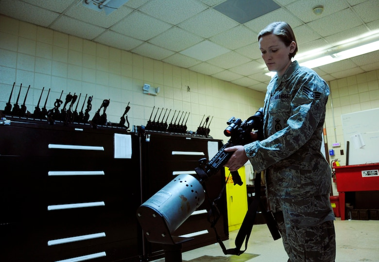 U.S. Air Force Senior Airman Kristine Koch, 145th Security Forces Squadron, safely utilizes a clearing barrel before issuing an M4 rifle during unit training at the North Carolina Air National Guard base, Charlotte Douglas Intl. Airport, Mar 21, 2015. Koch, who completed her first Professional Military Education milestone, Feb 12, 2015, as a distinguished graduate from Airman Leadership School has been with 145th SFS since Oct 2012. (U.S. Air National Guard photo by Master Sgt. Patricia F. Moran, 145th Public Affairs/Released)