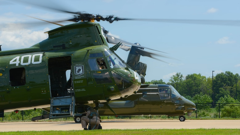 A Marine with Marine Medium Helicopter Squadron 774 locks the wheels of the Boeing Vertol CH-46 Sea Knight in place, Aug. 1, 2015 before the CH-46 Last Flight Retirement Ceremony at the Smithsonian Institution Nation Air and Space Museum Steven F. Udvar-Hazy Center in Chantilly, Virginia. The CH-46's main mission has been to provide combat support, however, the aircraft also flew resupply missions, medical evacuations and tactical recovery of aircraft and personnel.