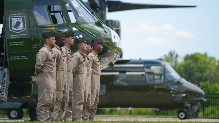 Marines with Marine Medium Helicopter Squadron 774 stand ready for the playing of Anchors Aweigh and the Marines Hymn Aug. 1, 2015 during the CH-46 Last Flight Retirement Ceremony at the Smithsonian Institution National Air and Space Museum Steven F. Udvar-Hazy Center in Chantilly, Virginia. The CH-46's main mission has been to provide combat support, however, the aircraft also flew resupply missions, medical evacuations and tactical recovery of aircraft and personnel.