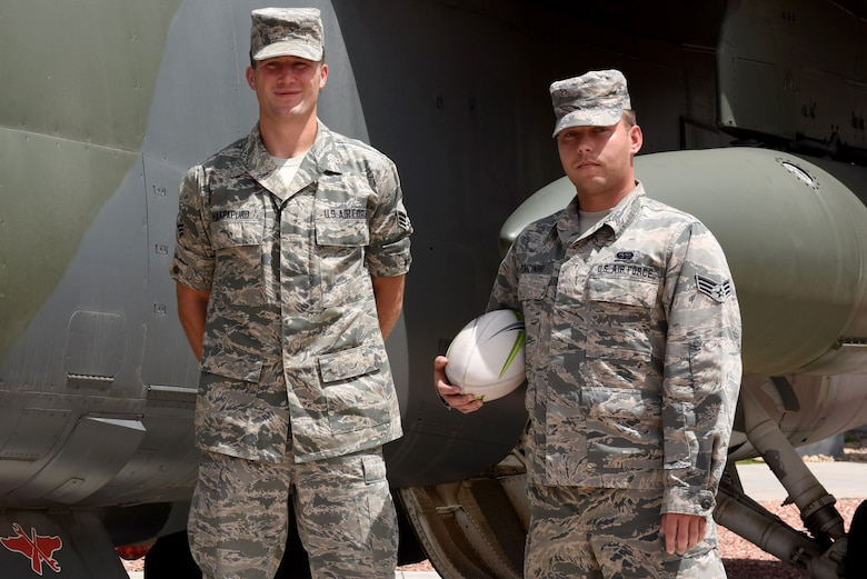 Senior Airman Benjamin A. Haapapuro, a space systems maintainer, and Senior Airman Theodore J. Szarzynski, a space warning specialist, both assigned to the 233d Space Group in Greeley, Colo. are members of the official Air Force Rugby team that will compete in the Armed Forces Rugby Championship August 14-15 at Infinity Park, Glendale, Colo. (US Air National Guard Photo by SrA Michelle Alvarez-Rea)