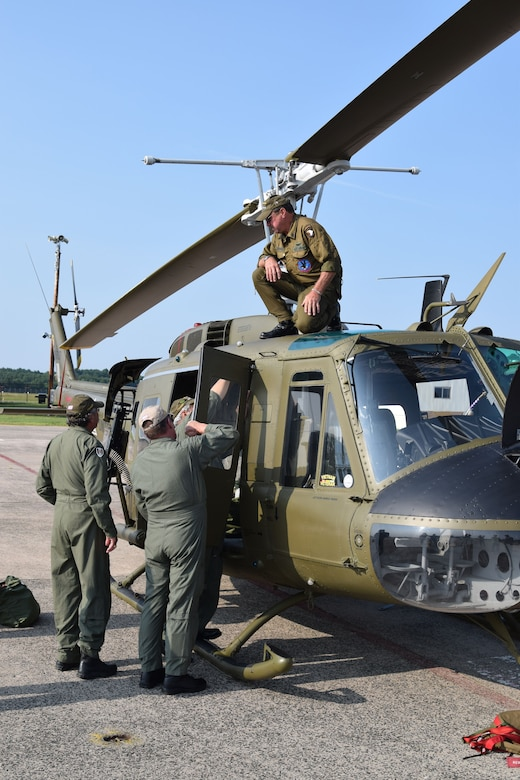 American Huey 369 crewmen, prepare their UH-1 Huey for the commemoration event.  The crew, veteran military pilots and technicians, travels across the country for military and aircraft commemorative events. (Photo by Staff Sgt. Benjamin Simon, JFHQ Public Affairs)