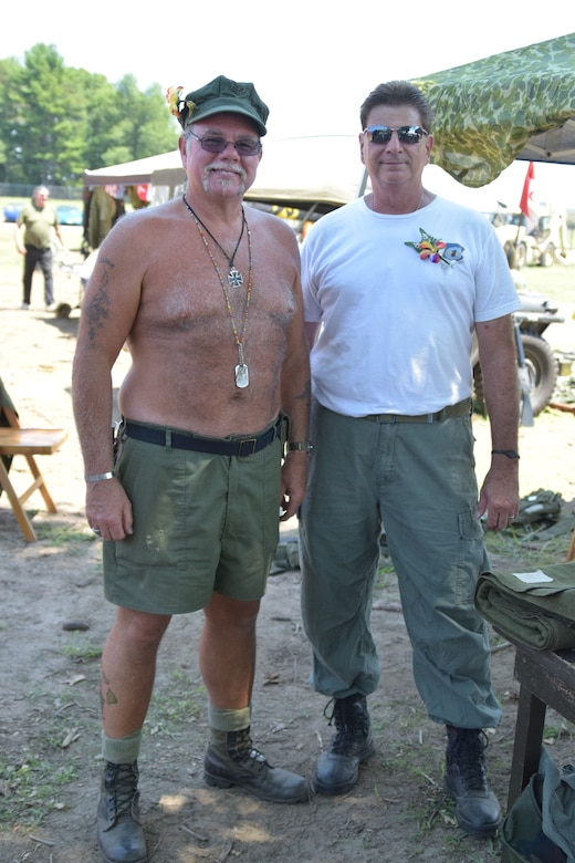 """""""Seabees don't wear shirts,"""" said Mark Crob, who served 28 years in the Navy, which included service in Vietnam. Crob and Rick Telesca exhibited uniforms and gear from the Vietnam era. (Photo by Staff Sgt. Benjamin Simon, JFHQ Public Affairs)"""