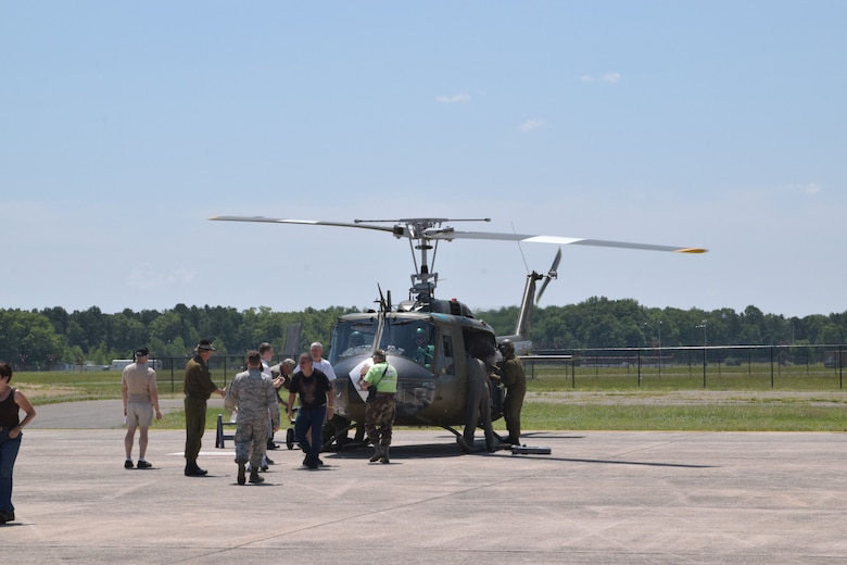 Guests were given an opportunity to take short flights in a  UH-1 Huey. The crew, veteran military pilots and technicians, work for American Huey 369, which travels across the country for military and aircraft commemorative events. (Photo by Staff Sgt. Benjamin Simon, JFHQ Public Affairs)
