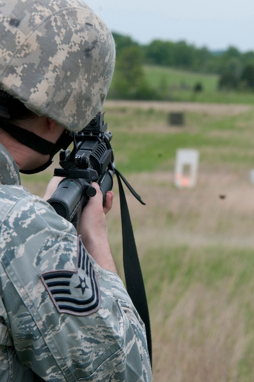Tech Sgt. Bucky Harris, a Combat Arms Training and Maintenance team member from the Kentucky Air National Guard's 123rd Security Forces Squadron, fires practice rounds from the M203 grenade launcher during annual weapons qualifications training at Fort Knox, Kentucky, May 17, 2015. (U.S. Air National Guard photo by Staff Sgt. Vicky Spesard)