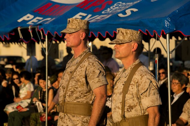 Brigadier Gen. Russell A. Sanborn, right, stands in front of 1st Marine Aircraft Wing with Maj. Gen. Steven R. Rudder, before assuming command of the wing during a ceremony at Marine Corps Air Station Futenma, Okinawa, Japan, July 30, 2015. Sanborn recently served as the director of Marine and Family Programs in Quantico, Virginia. Rudder will become the director of J5 Strategic Planning and Policy Directorate, Pacific Command. (U.S. Marine Corps photo by Cpl. Devon Tindle/Released)