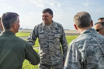 Col. Devin Wooden, 137th Air Refueling Wing commander,  greets Lt. Gen. Bradley Heithold, Air Force Special Operations Command commander, before a ribbon cutting ceremony at Will Rogers Air National Guard Base, Okla., Aug. 1, 2015. The Oklahoma guard unit celebrated the MC-12W's arrival. (Air National Guard photo by Senior Airman Tyler Woodward/Released)