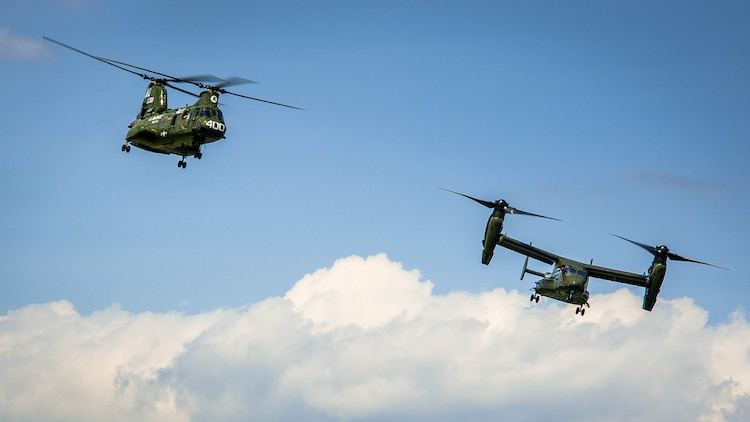 The CH-46 and MV-22 Osprey begins their landing during the CH-46 Retirement Ceremony at the Smithsonian Institution National Air and Space Museum's Steven Udvar-Hazy Center in Chantilly, Virginia Aug. 1, 2015. The ceremony was conducted by Marines from Medium Helicopter Squadron 774 4th Marine Aircraft Wing, Marine Corps Forces Reserve, and Marines from Marine Helicopter Squadron One from Marine Corps base Quantico, Virginia.