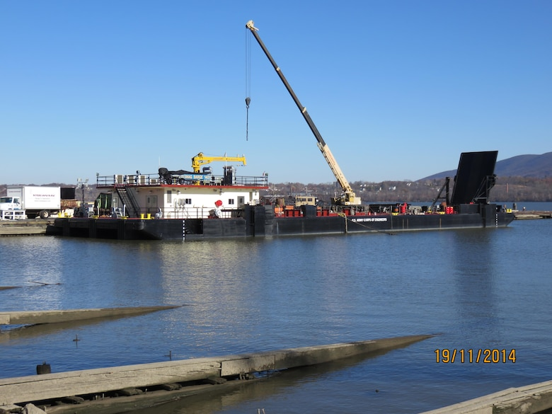 """The U.S. Army Corps of Engineers' Marine Design Center managed the design and construction of the USACE CRANE BARGE """"GRAVEL SPREADER 1101."""" The vessel was commissioned in February of 2012."""