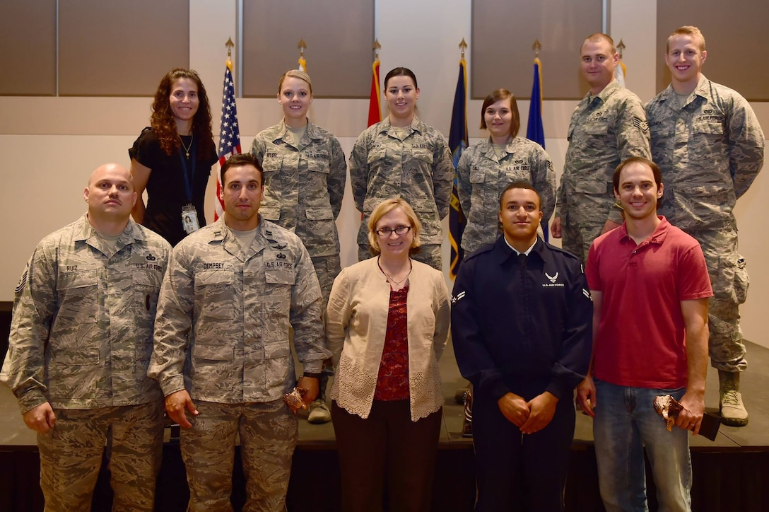 Senior Airman McCall Taylor, Air Reserve Personnel Center total force assignment technician, stands among Team Buckley quarterly award winners July 30, 2015, on Buckley Air Force Base, Colo. The award winners were chosen because of their hard work and dedication in their work centers. (U.S. Air Force photo by Airman 1st Class Luke W. Nowakowski)