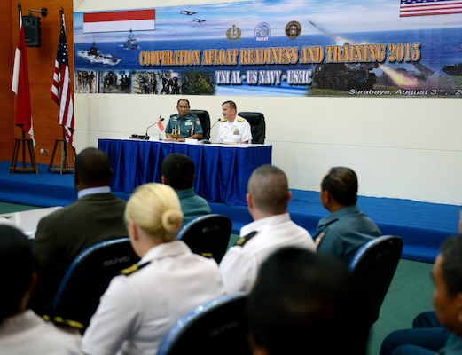 SURABAYA, Indonesia (Aug. 3, 2015) - Rear Adm. Charlie Williams, commander, Task Force (CTF) 73, and Indonesia Assistant Chief of Navy Rear Adm. Arie H. Sembiring address U.S. and Indonesian military members during the opening ceremony of Cooperation Afloat Readiness and Training (CARAT) Indonesia 2015.  In its 21st year, CARAT is an annual, bilateral exercise series with the U.S. Navy, U.S. Marine Corps and the armed forces of nine partner nations including, Bangladesh, Brunei, Cambodia, Indonesia, Malaysia, the Philippines, Singapore, Thailand and Timor-Leste.