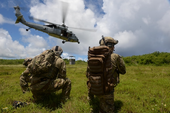 U.S. Air Force Tactical Air Control Party Airmen with the 3rd Air Support Operations Squadron from Joint Base Elmendorf-Richardson, Alaska, watch as an MH-60S Seahawk takes off July 22, 2015, Andersen Air Force Base, Guam. The joint terminal attack controller team conducted essential close air support training. (U.S. Air Force photo by Staff Sgt. Alexander W. Riedel/Released)