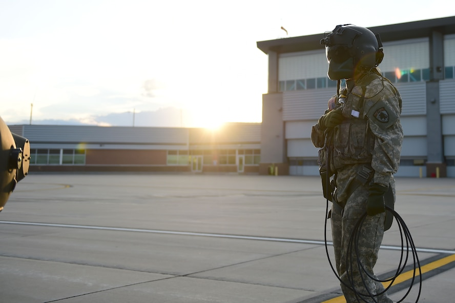 Sgt. Barbara Shirley, 2-135th Aviation Battalion crew chief, looks over a UH-60 Black Hawk before takeoff July 29, 2015, on Buckley Air Force Base, Colo. The 2-135th Aviation Battalion is part of the Colorado Army National Guard and has a variety of capabilities that make it a valuable resource to both the state of Colorado and the U.S. Army. (U.S. Air Force photo by Airman 1st Class Luke W. Nowakowski/Released)