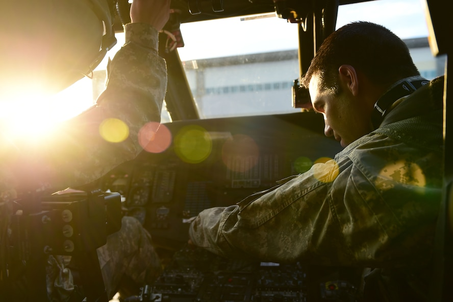 Chief Warrant Officer Craig Wenkheimer, 2-135th Aviation Battalion UH-60 Black Hawk pilot, goes through pre-flight checks July 29, 2015, on Buckley Air Force Base, Colo. The 2-135th Aviation Battalion is part of the Colorado Army National Guard and has a variety of capabilities that make it a valuable resource to both the state of Colorado and the U.S. Army. (U.S. Air Force photo by Airman 1st Class Luke W. Nowakowski/Released)