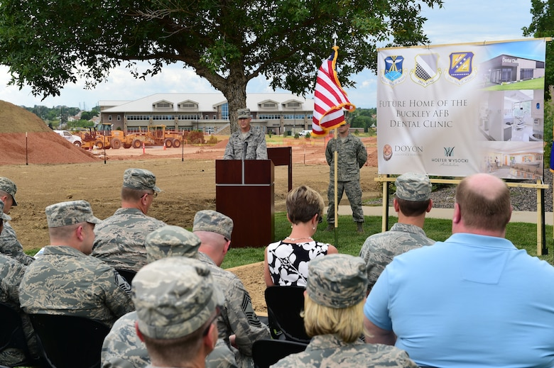 Col. Michael Kindt, 460th Medical Group commander, addresses an audience before breaking ground for the new dental clinic Aug. 3, 2015, on Buckley Air Force Base, Colo. The expansion and reconfiguration of the 460th MDG and 140th MDG building is expected to be completed June 2016. (U.S. Air Force photo by Airman 1st Class Luke W. Nowakowski/Released)