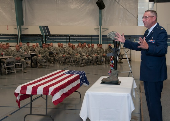Maj. Steve Peters, a chaplain with the 185th Air Refueling Wing, preaches to members of the 185th ARW during a memorial service for Senior Airman Drew Bellairs in Sgt. Bluff, Iowa on August 1, 2015. The memorial service honored Bellairs who passed away on July 25, 2015. (U.S. Air National Guard Photo by: Tech Sgt. Oscar Sanchez/185th ARW Wing Public Affairs Released)