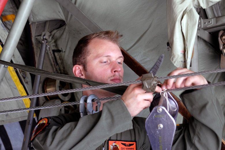 U.S. Air Force Senior Airman Zachary A. Sidders, a loadmaster with the 169th Airlift Squadron, performs maintenance during training at the 182nd Airlift Wing, Peoria, Ill., Aug. 1, 2015. The training was conducted to ensure that the loadmasters are always on mission and ready for real-world scenarios. (U.S. Air National Guard photo by Tech. Sgt. Dawn Rademaker/Released)
