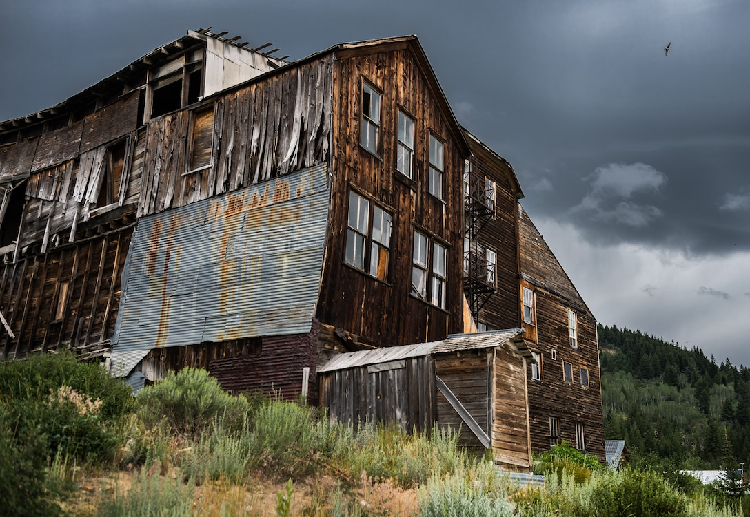 A weathered and beaten hotel lies in the forgotten town of Silver City, Idaho. Once a bustling mining settlement, it's veins have run dry and abandon mine shafts litter the Mountainside. (U.S. Air Force photo by Airman 1st Class Connor J. Marth)