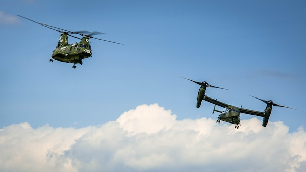The Ch-46 and V-22 Osprey begins there landing during the CH-46 Retirement Ceremony at the Smithsonian Institution National Air and Space Museum's Steven Udvar-Hazy Center in Chantilly, Virginia Aug. 1, 2015. The ceremony was conducted by Marines from Medium Helicopter Squadron 774 4th Marine Aircraft Wing, Marine Corps Forces Reserve, and Marines from Marine Helicopter Squadron One from Marine Corps base Quantico, Virginia.