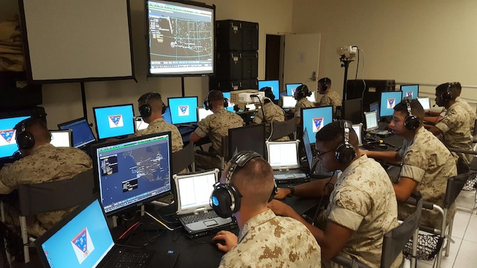 ACEOC 15-2 students are introduced to the latest Command and Control (C2) system currently being field in the Fleet Marine Force (FMF) for the first time. The students are familiarizing themselves with the Common Aviation C2 System (CAC2S) by navigating around maps and airspaces used during their formal school training.