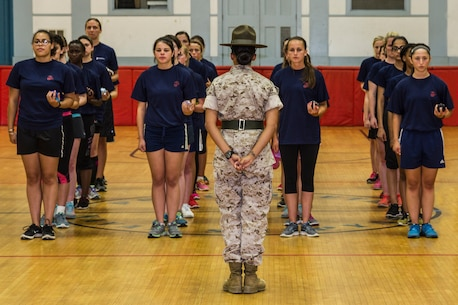 Sergeant Jessica Paz inspects the uniformity of the poolee platoon prior to drill practice aboard the Portsmouth naval Shipyard, Aug. 1. Recruiting Station Portsmouth held a female pool function where female applicants take the initial strength test and are given some background information on the female side of recruit training. Paz is a drill instructor with 4th Recruit Training Battalion aboard Marine Corps Recruit Depot Parris Island, South Carolina.