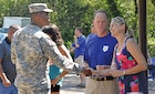 Fort Riley Garrison Commander Col. Andrew Cole, Jr. socializes with guests at the 240th Anniversary of the Army Chaplain Corps at Moon Lake July 24.