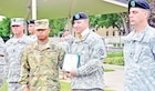 Staff Sgt. Scott Cash and Staff Sgt. Daniel Sutterly, both of the 300th Military Police Company, 97th MP Battalion, 89th Military Police Brigade, Fort Hood, Texas, received an Impact Army Commendation Medal, brigade coin of excellence and a four-day pass just before the Change of Responsibility ceremony for the 97th MP Bn at Cavalry Parade Field on July 10.    The recognition was given by Col. Ross Guieb, the 89th MP Brigade commander.  Cash was recognized for a heroic act that took place July 9.  Cash was driving down Highway 77 that afternoon when he responded to an injury accident involving three victims.  Cash rendered aid to the victims of the accident, while Staff Sgt. Sutterly directed traffic away from the accident.  Once EMS arrived on scene, Cash provided EMS with a proper patient exchange, describing injuries sustained, interventions taken and what the patients' vital signs were.  He then waited till all three patients were safely loaded before leaving the accident scene.
