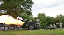 """Soldiers from the 1st Battalion, 5th Field Artillery Regiment, 1st Armored Brigade Combat Team, 1st Infantry Division fire a cannon salute during a July 20 retirement ceremony in honor of Air Force Lt. Gen. James M. Kowalski, U.S. Strategic Command deputy commander, at Offutt Air Force Base, Nebraska. The """"Hamilton's Own"""" Soldiers attended the event as part of a detail to support official military ceremonies within the region. USSTRATCOM is one of nine Department of Defense unified combatant commands charged with strategic deterrence; space operations; cyberspace operations; joint electronic warfare; global strike; missile defense; intelligence, surveillance and reconnaissance; combating weapons of mass destruction; and analysis and targeting."""