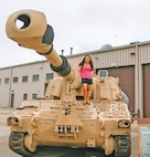 Family members enjoy the military equipment displays. Six military vehicles were on display for Molly Pitcher Day.
