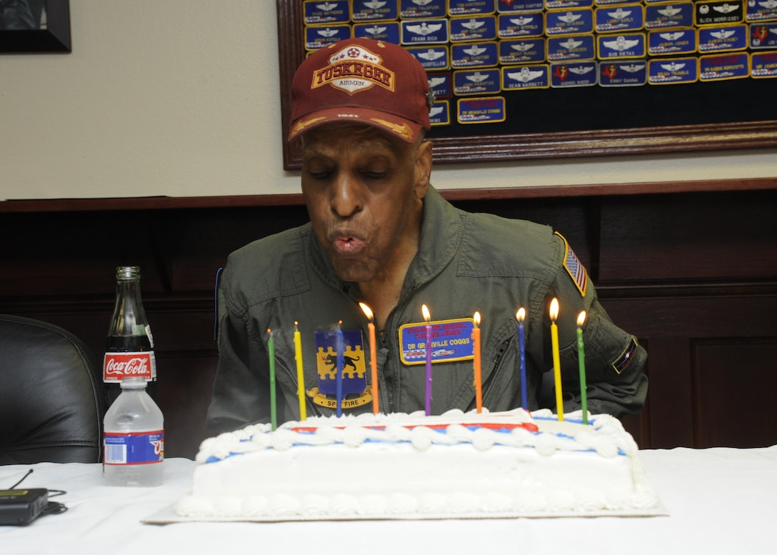 Dr. Granville Coggs, documented original Tuskegee Airman, blows out the candles on his 90th birthday cake during a celebration with the 99th Flying Training Squadron July 30 at Joint Base San Antonio-Randolph. As well as serving as one of the Tuskegee Airmen, Coggs worked for 30 years as a diagnostic radiologist focusing on breast cancer detection. Coggs currently lives in San Antonio with his wife, Maud.