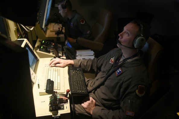Staff Sgt. Lloyd (left), an 18th Reconnaissance Squadron MQ-1B Predator sensor operator, and Capt. Benjamin, an 18th RS Predator pilot, fly a remotely piloted aircraft training sortie in support of Red Flag 15-3 at Creech Air Force Base, Nev., July 23, 2015. The goal of participating in Red Flag exercises was to fully integrate RPAs into large force exercises and to educate other major weapon systems communities on the RPA capabilities. (U.S. Air Force photo/Tech. Sgt. Nadine Barclay)