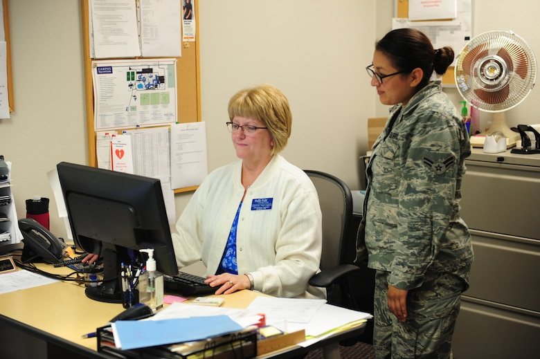 Jeannie Harrington, State Fair Community College administrative assistant, counsels Airman 1st Class Heather De Leon Ventura, 509th Maintenance Group administrator, July 30, 2015, at Whiteman Air Force Base, Mo. After speaking with an education specialist, a service member or dependent can check out the schools available at the Professional Development Center for information on the admission process or counseling on classes. (U.S. Air Force photo by Airman 1st Class Jazmin Smith/Released)