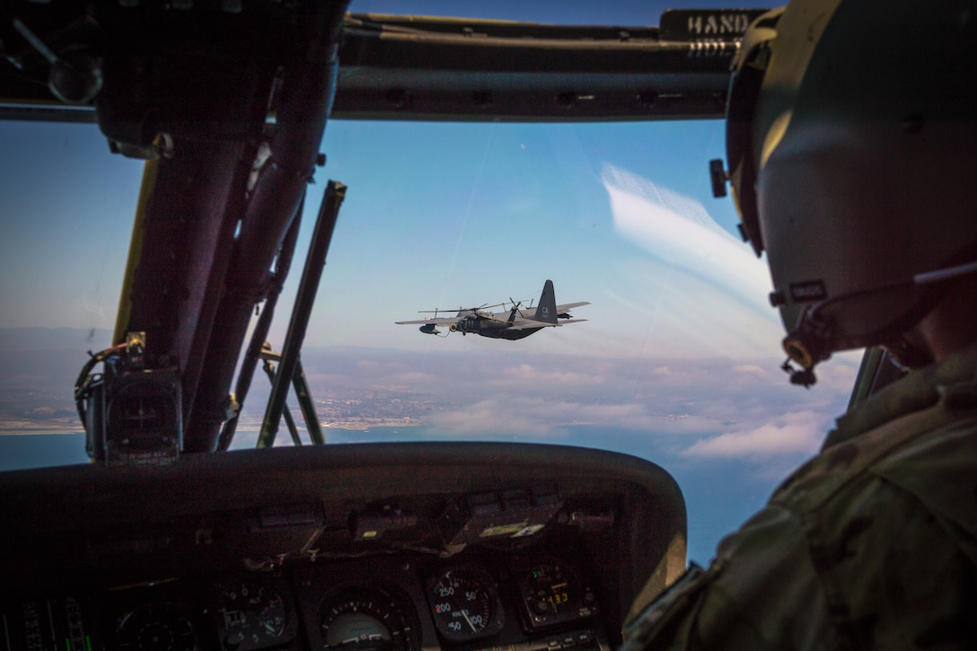U.S. California Air National Guardsmen from the 129th Rescue Squadron, Moffett Federal Airfield, Calif., perform aerial refuel during the Angel Thunder 2015 search and rescue training scenario seven miles off the coast of Marine Corp Base Camp Pendleton, Calif., June 7, 2015.  ANGEL THUNDER focuses on scenarios that rescue forces are likely to face in current and future contingencies—increasing their combat readiness across a range of military options. (Courtesy photo by Tech. Sgt. Michael Wang)