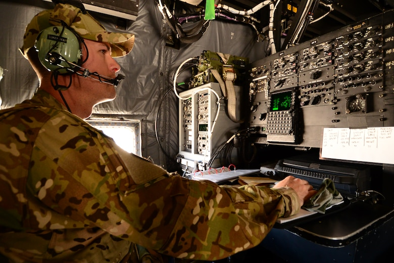 U.S. California Air National Guardsman, Airman 1st Class Brandon Lukenbill, Radio Operator with the 130th Rescue Squadron, Moffett Federal Airfield, Calif., monitor radio transmissions onboard an MC-130P Combat Shadow aircraft during Angel Thunder2015 exercises at Davis-Monthan Air Force Base, Ariz., June 3, 2015. Angel Thunder takes place throughout the Southwest; from the U.S.-Mexico Border north to Colorado, and from Arizona to the California coast. Angle Thunder provides the opportunity for all participating members the ability to showcase personnel recovery, joint force integration and interagency participation to internal and external audiences.(U.S. Air National Guard photo by Senior Airman Rachael Kane/Released)