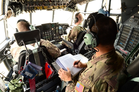 U.S. California Air National Guardsman Capt. Kenley Lok, Combat Systems operator with the 130th Rescue Squadron, Moffett Federal Airfield, Calif., determines the location of the MC-130P Combat Shadow aircraft during Angel Thunder 2015 exercises, Davis-Monthan AFB, Ariz., June 5, 2015. Determining correct location coordinates is vital during search and rescue operations.  (U.S. Air National Guard photo by Senior Airman Rachael Kane/Released)