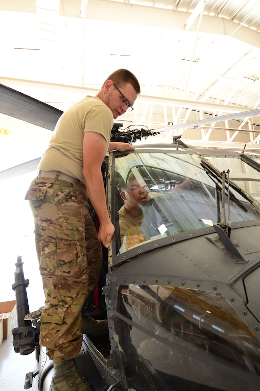 U.S. California Air National Guardsman, Tech. Sgt. Joshua Tidwell, crewchief with the 129th Aircraft Maintenance Squadron, Moffett Federal Airfield, Calif., removes the windshield from a HH-60 Pavehawk helicopter at Davis-Monthan AFB, Ariz., June 2, 2015. The windshield was damaged during Angel Thunder 2015 exercises. (U.S. Air National Guard photo by Senior Airman Rachael Kane/Released)