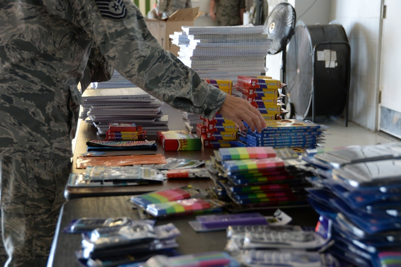 U. S. Air Force Airmen browse school supplies donated to military personnel by local community members through Operation Home front: Back to School Brigade. This operation gives back to those who serve the community as a member of the armed services. (U.S. Air National Guard photo by Airman 1st Class Kevin D. Schulze/Released)