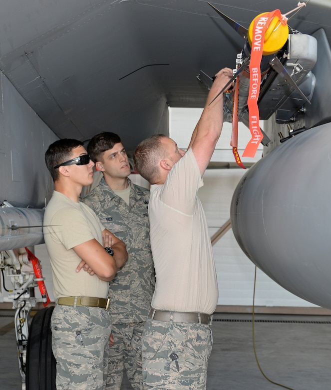 Members from the 9th Civil Engineer Squadron Explosive Ordinance Disposal Flight, receive training on the F-15 Eagles loading pins from a member from the 173rd Fighter Wing at Kingsley Field Air National Guard Base, Oregon, July 31, 2015. Beale's EOD received hands on training and provided safety support for Sentry Eagle 15 July 30 to Aug. 2, 2015. (U.S. Air Force photo by Airman 1st Class Ramon A. Adelan)